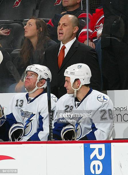 Head Coach Rick Tocchet of the Tampa Bay Lightning gives instructions against the New Jersey Devils during their game at the Prudential Center on...