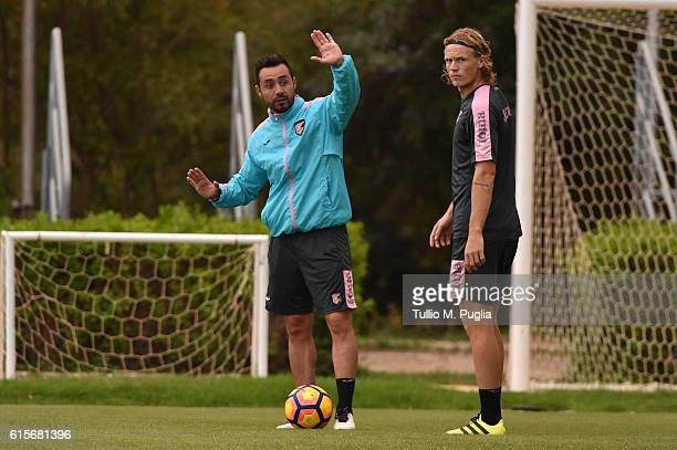Head coach Roberto De Zerbi and Oscar Hiljemark in action during a US Citta' di Palermo training session at Carmelo Onorato training center at Campo...