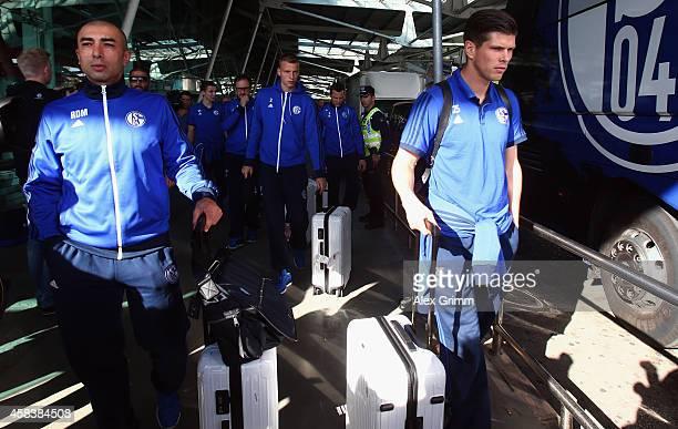 Head coach Roberto di Matteo and KlaasJan Huntelaar of FC Schalke 04 arrive at Lisbon airport one day ahead of their UEFA Champions League Group G...