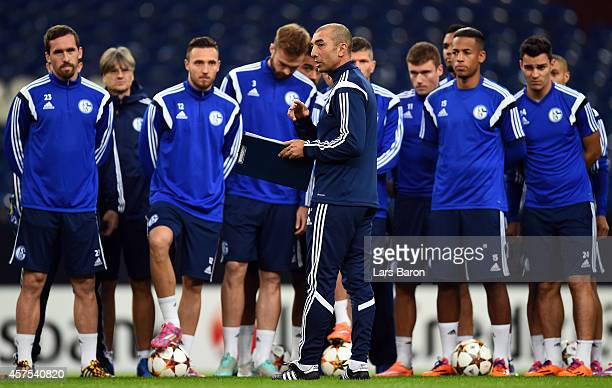 Head coach Roberto di Matteo gives instructions to his players during a FC Schalke 04 training session ahead of their Champions League match against...