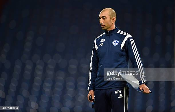 Head coach Roberto di Matteo looks on during a FC Schalke 04 training session ahead of their Champions League match against Sporting Clube de...