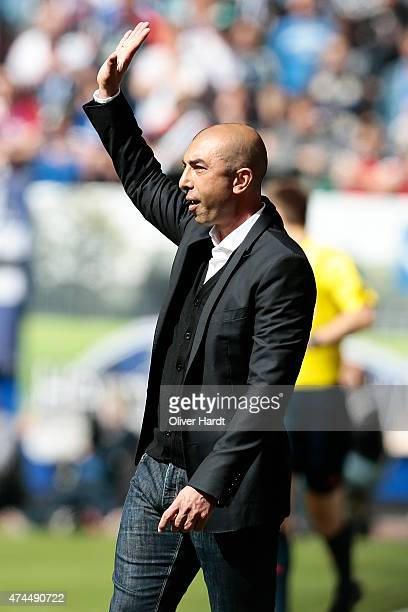Head coach Roberto Di Matteo of Schalke gesticulated during the First Bundesliga match between Hamburger SV and FC Schalke 04 at Imtech Arena on May...