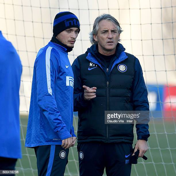 Head coach Roberto Mancini and Adem Ljajic chat during the FC Internazionale training session at the club's training ground at Appiano Gentile on at...