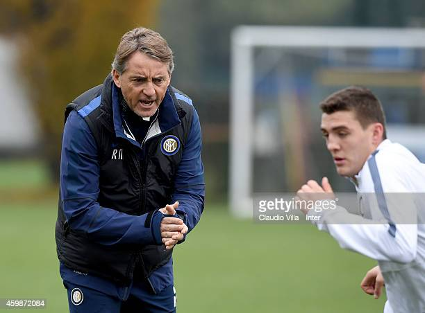 Head coach Roberto Mancini and Mateo Kovacic during FC Internazionale Training Session at Appiano Gentile on December 03 2014 in Como Italy