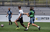 Head coach Roberto Mancini and Miranda compete for the ball during the FC Internazionale training session at University of Portland on July 20 2016...