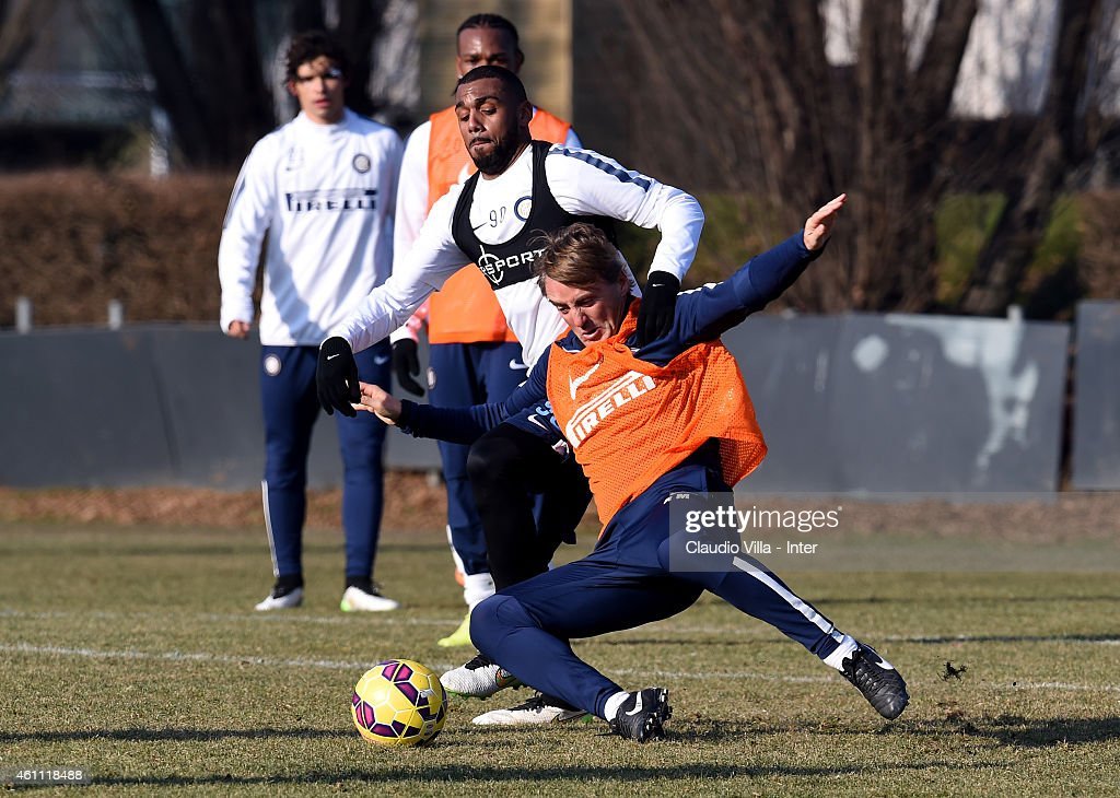 Head coach Roberto Mancini (R) and Yann M'Vila compete for the ball during the FC Internazionale Training Session at Appiano Gentile on January 07, 2015 in Como, Italy.