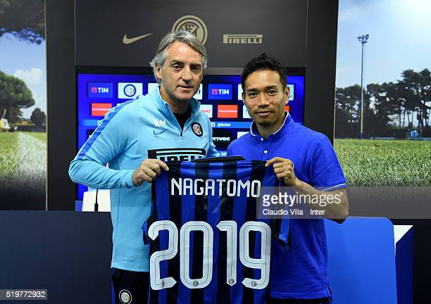 Head coach Roberto Mancini and Yuto Nagatomo of FC Internazionale pose for a photo prior to the press conference at the club's training ground at...