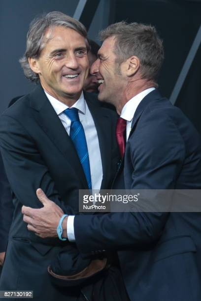 Head coach Roberto Mancini of FC Zenit Saint Petersburg and FC Spartak Moscow head coach Massimo Carrera during the Russian Football League match...