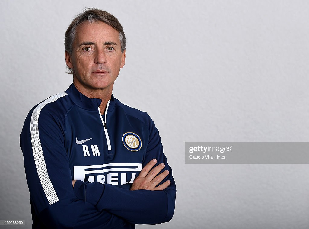 Head coach <a gi-track='captionPersonalityLinkClicked' href=/galleries/search?phrase=Roberto+Mancini&family=editorial&specificpeople=234429 ng-click='$event.stopPropagation()'>Roberto Mancini</a> poses prior to the FC Internazionale Training Session at Appiano Gentile on November 19, 2014 in Como, Italy.