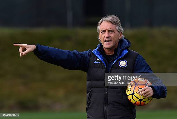 Head coach Roberto Mancini reacts during a FC Internazionale training session at the club's training ground at Appiano Gentile on October 29 2015 in...