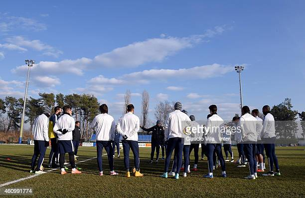 Head coach Roberto Mancini speaks to his players during the FC Internazionale Training Session at Appiano Gentile on January 03 2015 in Como Italy