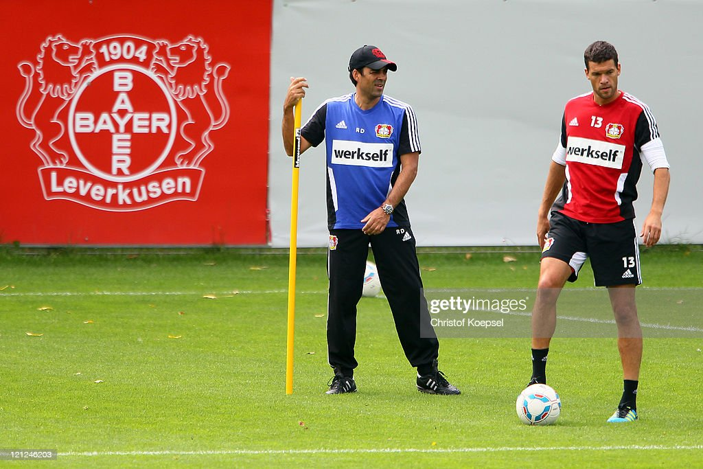 Head coach Robin Dutt and Michael Ballack attend the training session of Bayer Leverkusen at the training ground at Bayarena on August 16 2011 in...