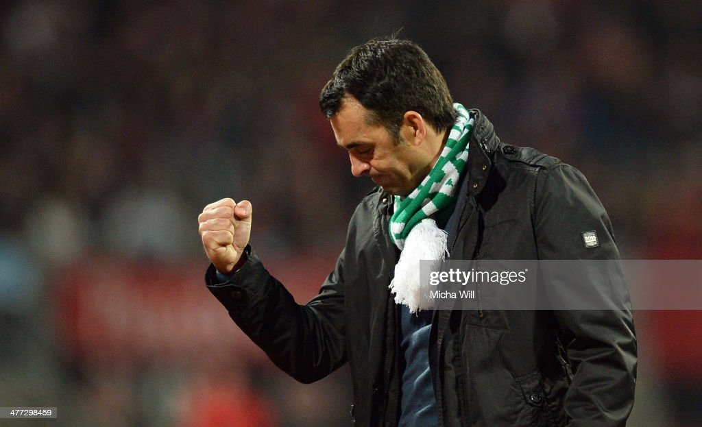 Head coach Robin Dutt of Bremen clenches his fist after his teams victory during the Bundesliga match between 1 FC Nuernberg and Werder Bremen at...