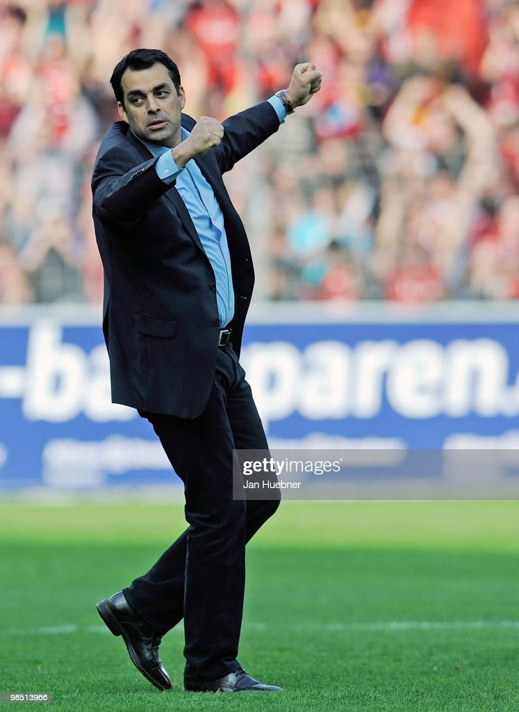 Head Coach Robin Dutt of Freiburg celebrates after the Bundesliga match between SC Freiburg and 1FC Nuernberg at Badenova Stadium on April 17 2010 in...