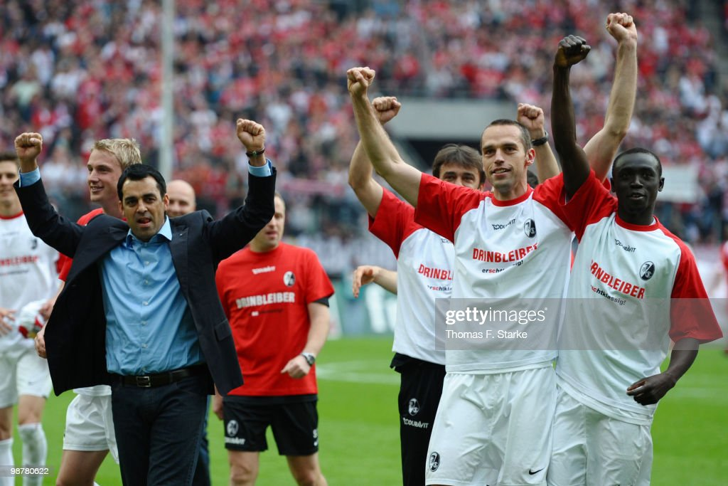 Head coach Robin Dutt of Freiburg celebrates with his team after the Bundesliga match between 1 FC Koeln and SC Freiburg at RheinEnergieStadion on...
