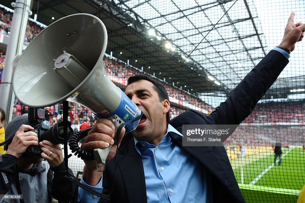 Head coach Robin Dutt of Freiburg celebrates with the supporters after the Bundesliga match between 1 FC Koeln and SC Freiburg at RheinEnergieStadion...
