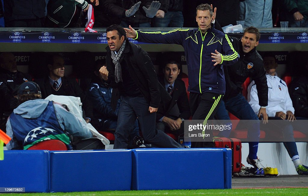 Head coach Robin Dutt of Leverkusen celebrates infront of the Velancia bench after Sidney Sam scored his teams second goal during the UEFA Champions...