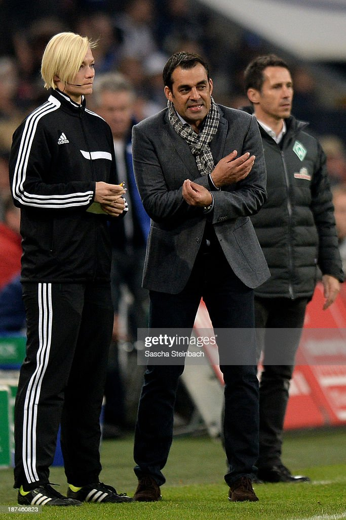 Head coach <a gi-track='captionPersonalityLinkClicked' href=/galleries/search?phrase=Robin+Dutt&family=editorial&specificpeople=3175490 ng-click='$event.stopPropagation()'>Robin Dutt</a> (R) reacts next to the 4th official <a gi-track='captionPersonalityLinkClicked' href=/galleries/search?phrase=Bibiana+Steinhaus&family=editorial&specificpeople=2299795 ng-click='$event.stopPropagation()'>Bibiana Steinhaus</a> (L) during the Bundesliga match between FC Schalke 04 and Werder Bremen at Veltins-Arena on November 9, 2013 in Gelsenkirchen, Germany.