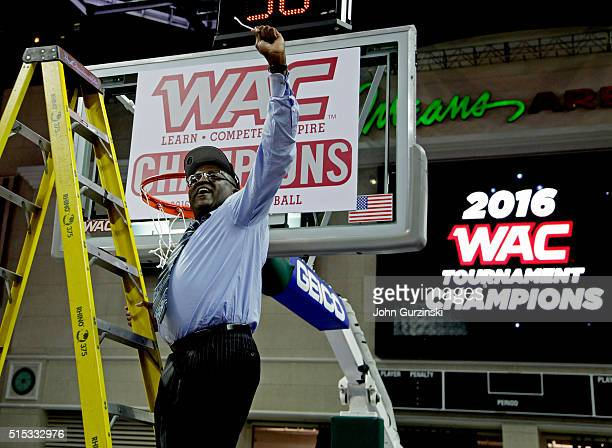 Head coach Rod Barnes of the Cal State Bakersfield Roadrunners celebrates cutting a piece of the net after beating the New Mexico State Aggies 5754...