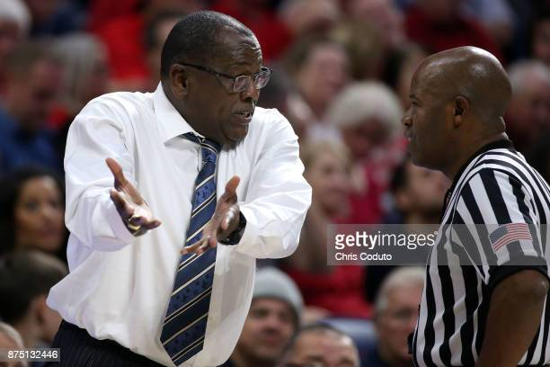 Head coach Rod Barnes of the Cal State Bakersfield Roadrunners talks with official Frank Harvey III during the fist half of the college basketball...