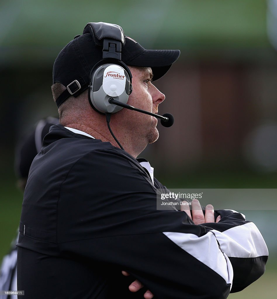 Head coach Rod Carey of the Northern Illinois Huskies watches as his team takes on the Eastern Michigan Eagles at Brigham Field on October 26, 2013 in DeKalb, Illinois. Northern Illinois defeated Eastern Michigan 59-20.