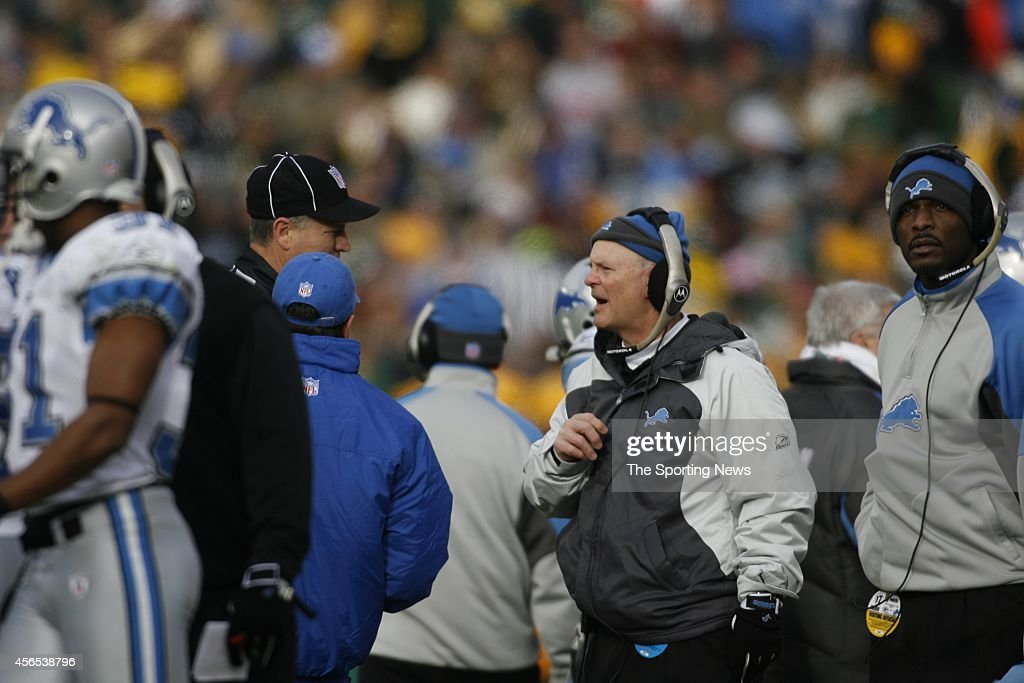 Head Coach <a gi-track='captionPersonalityLinkClicked' href=/galleries/search?phrase=Rod+Marinelli&family=editorial&specificpeople=597998 ng-click='$event.stopPropagation()'>Rod Marinelli</a> of the Detroit Lions looks on from the sidelines during a game against the Green Bay Packers on December 17, 2006 at Lambeau Field in Green Bay, Wisconsin.