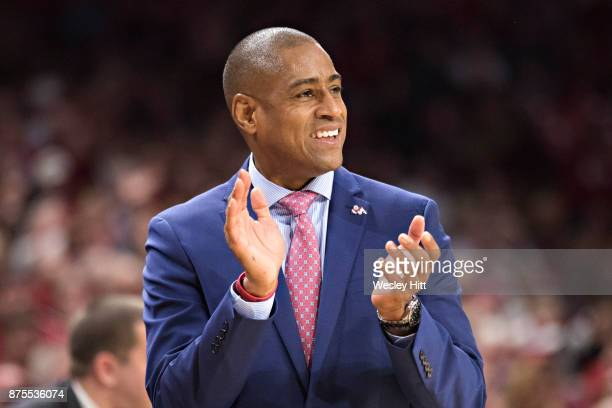Head Coach Rodney Terry of the Fresno State Bulldogs claps to encourage his team during a game against the Arkansas Razorbacks at Bud Walton Arena on...