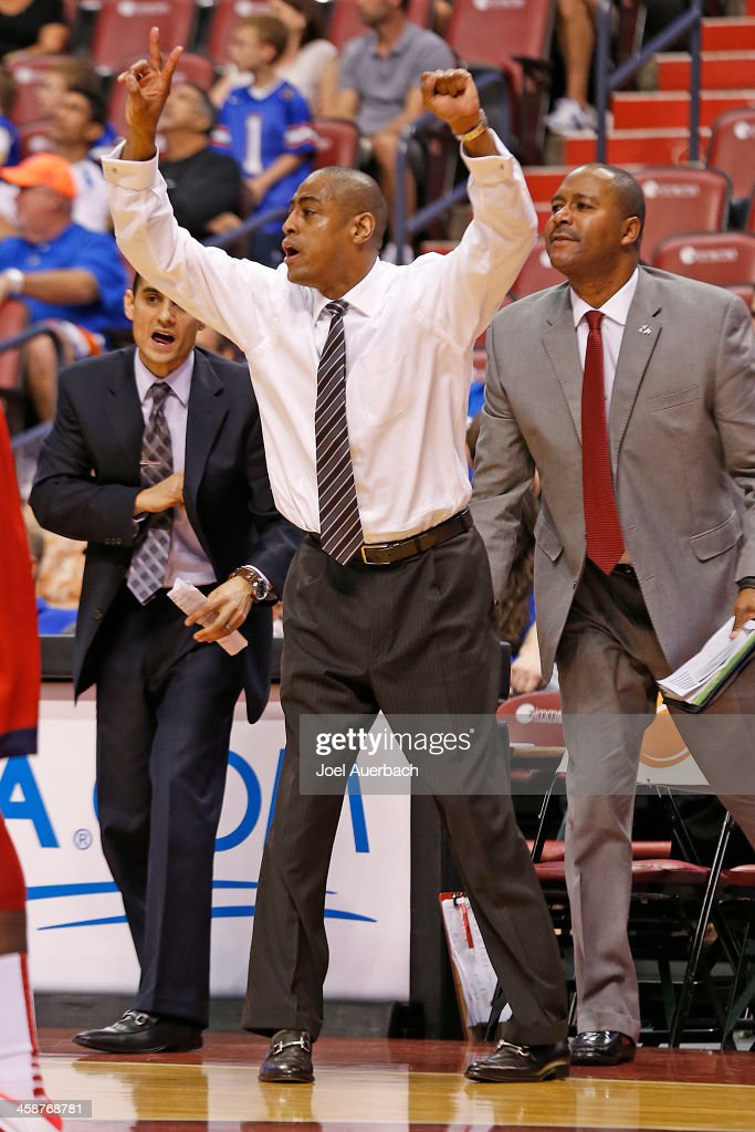 Head coach Rodney Terry of the Fresno State Bulldogs reacts to first half action against the Florida Gators during the MetroPCS Orange Bowl Basketball Classic on December 21, 2013 at the BB&T Center in Sunrise, Florida.