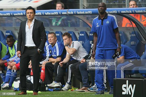 Head coach Rodolfo Cardoso and assistant coach Otto Addo of Hamburg look thoughtful during the Bundesliga match between Hamburger SV and Werder...