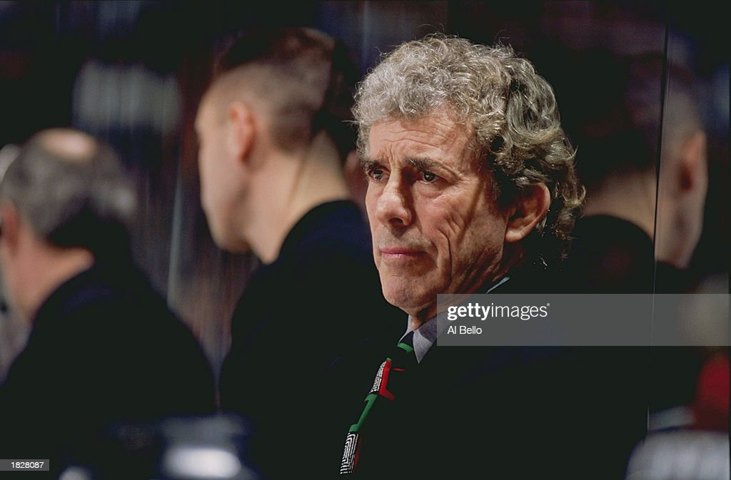 Head coach Roger Neilson of the Philadelphia Flyers watches from the bench during the game against the New Jersey Devils at the Continental Airlines Arena on April 16, 1999 in East Rutherford, New Jersey. The Devils defeated the Flyers 3-2.