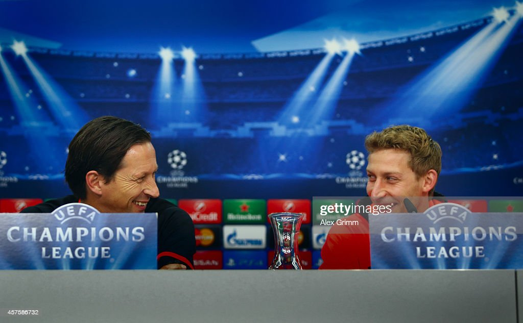 Head coach Roger Schmidt and Stefan Kiessling of Leverkusen attend a Bayer Leverkusen press conference ahead of their UEFA Champions League Group C...
