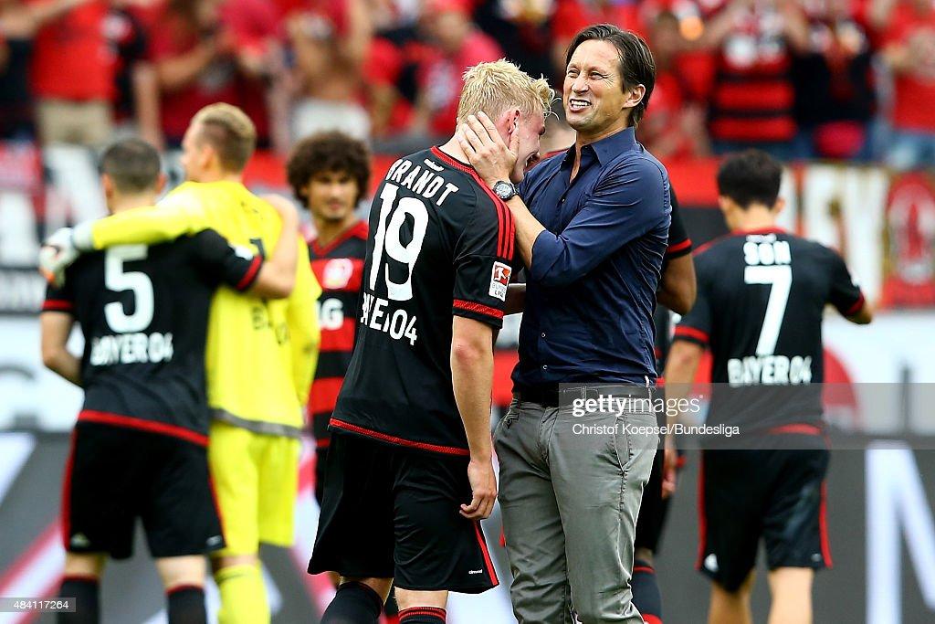 Head coach Roger Schmidt (R) embraces Julian Brandt of Leverkusen (L) after winning the Bundesliga match between Bayer Leverkusen and 1899 Hoffenheim at BayArena on August 15, 2015 in Leverkusen, Germany.