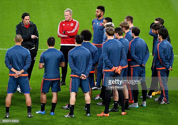 Head coach Roger Schmidt gives instructions to his players during a Bayer Leverkusen training session on the eve of the UEFA Champions League groupe...