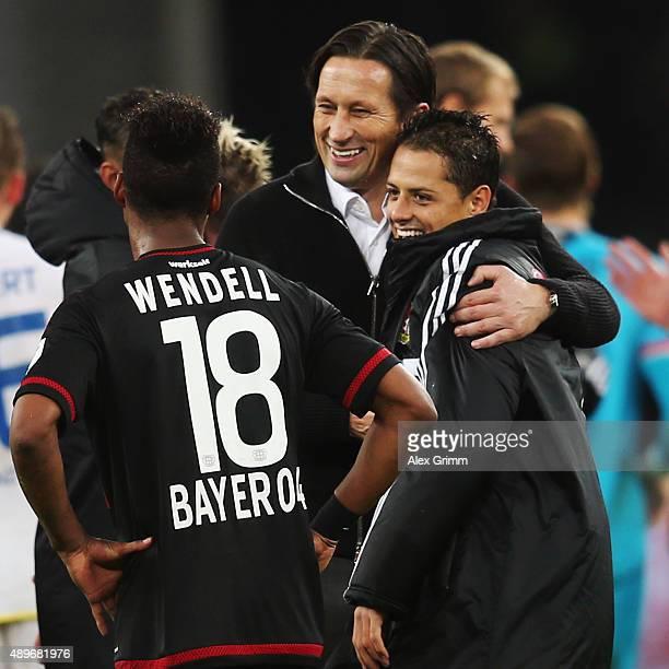 Head coach Roger Schmidt hugs Javier Hernandez after the Bundesliga match between Bayer Leverkusen and 1 FSV Mainz 05 at BayArena on September 23...