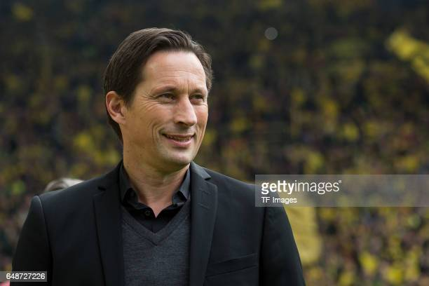 Head coach Roger Schmidt of Bayer Leverkusen laughs during the Bundesliga match between Borussia Dortmund and Bayer 04 Leverkusen at Signal Iduna...