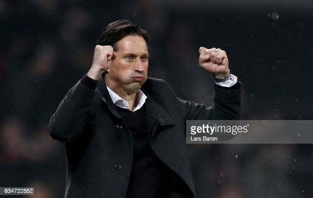 Head coach Roger Schmidt of Leverkusen celebrates after Chicharito of Bayer Leverkusen scores his teams second goal during the Bundesliga match...
