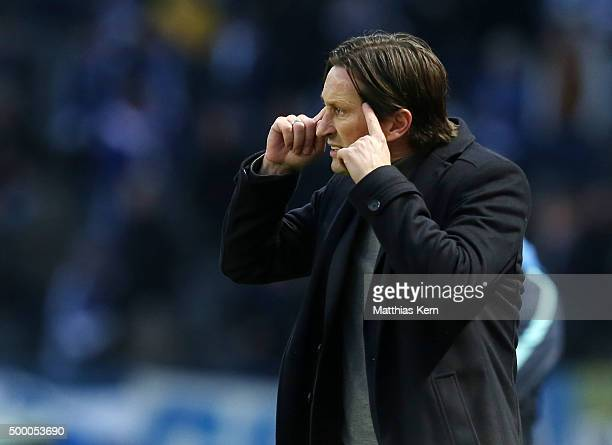 Head coach Roger Schmidt of Leverkusen gestures during the Bundesliga match between Hertha BSC and Bayer Leverkusen at Olympiastadion on December 5...