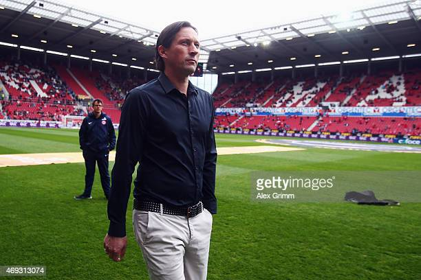 Head coach Roger Schmidt of Leverkusen looks on prior to the Bundesliga match between 1 FSV Mainz 05 and Bayer 04 Leverkusen at Coface Arena on April...