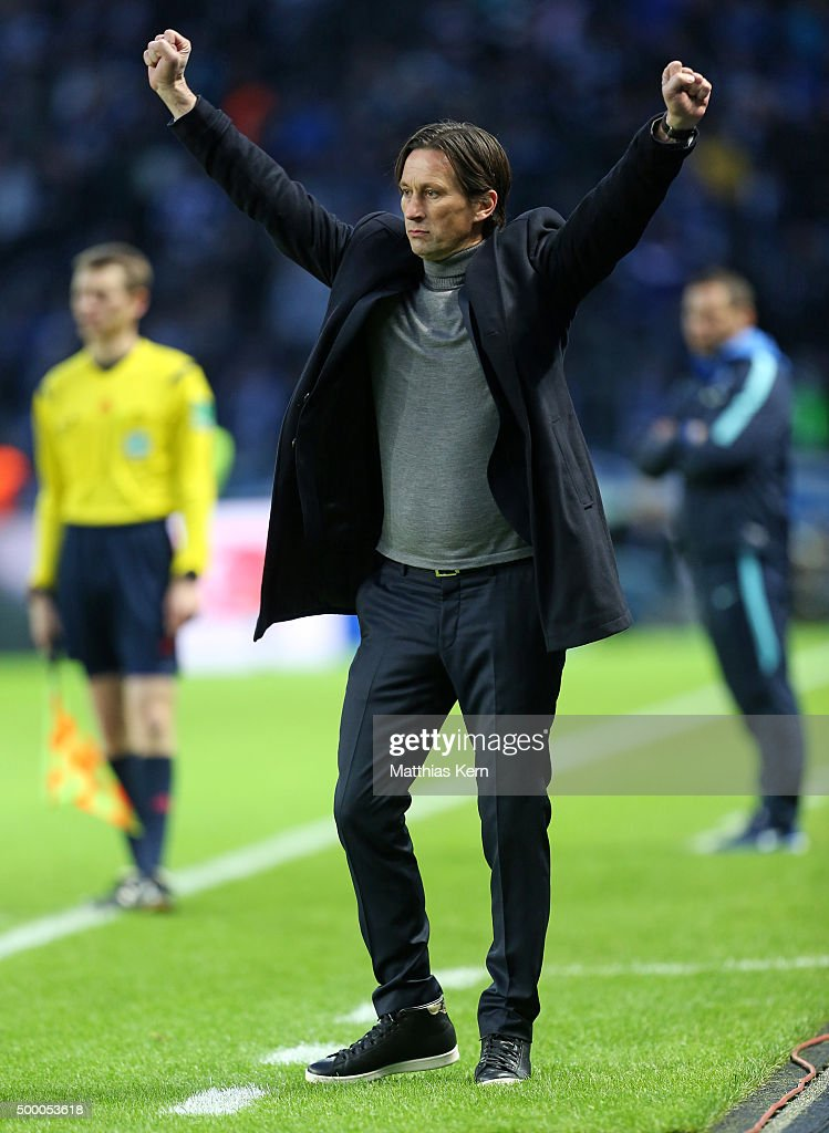 Head coach Roger Schmidt of Leverkusen shows his delight after Chicharito scoring the second goal during the Bundesliga match between Hertha BSC and Bayer Leverkusen at Olympiastadion on December 5, 2015 in Berlin, Germany.
