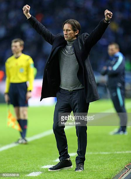 Head coach Roger Schmidt of Leverkusen shows his delight after Chicharito scoring the second goal during the Bundesliga match between Hertha BSC and...