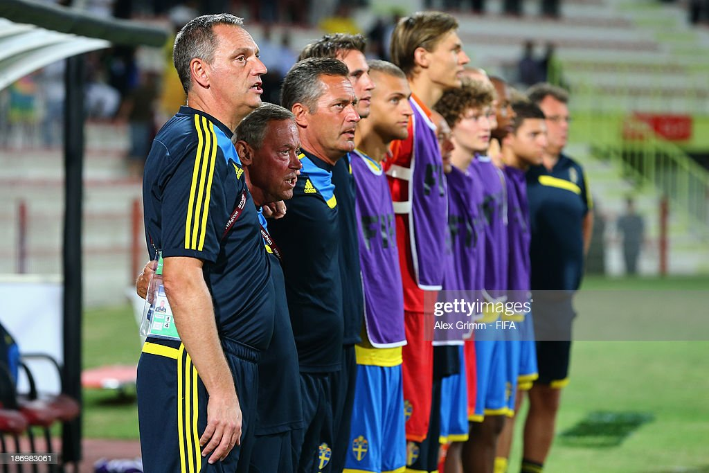 Head coach Roland Larsson of Sweden and team members sing their national anthem prior to the FIFA U-17 World Cup UAE 2013 Semi Final match between Sweden and Nigeria at Al Rashid Stadium on November 5, 2013 in Dubai, United Arab Emirates.