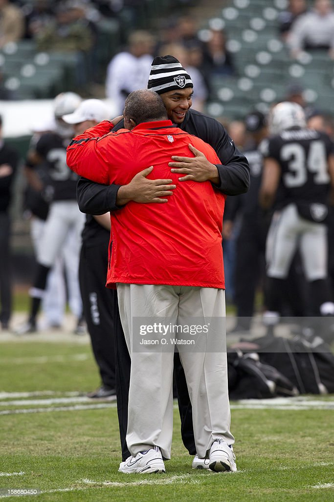 Head coach Romeo Crennel of the Kansas City Chiefs hugs defensive tackle Richard Seymour of the Oakland Raiders before the game at O.co Coliseum on December 16, 2012 in Oakland, California. The Oakland Raiders defeated the Kansas City Chiefs 15-0. Photo by Jason O. Watson/Getty Images)