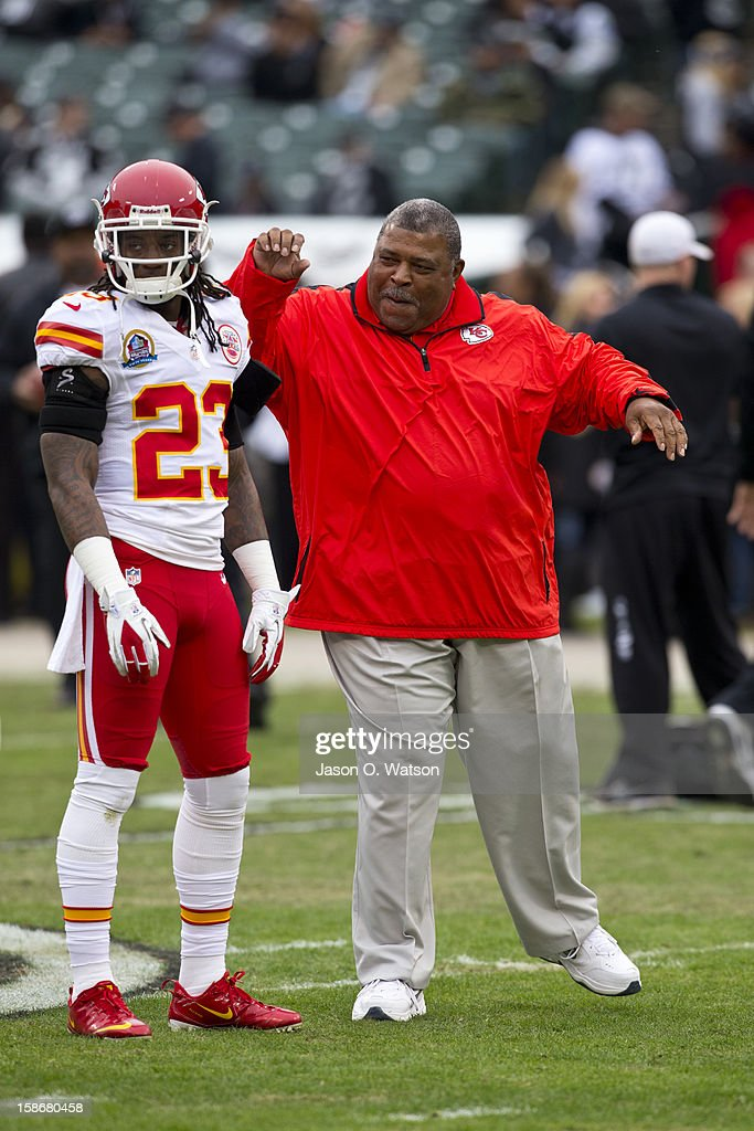 Head coach Romeo Crennel of the Kansas City Chiefs jokes with Kendrick Lewis #23 before the game against the Oakland Raiders at O.co Coliseum on December 16, 2012 in Oakland, California. The Oakland Raiders defeated the Kansas City Chiefs 15-0. Photo by Jason O. Watson/Getty Images)