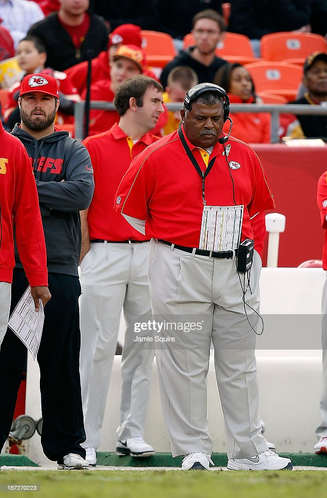 Head coach Romeo Crennel of the Kansas City Chiefs lowers his head on the sidelines during the game against the Cincinnati Bengals at Arrowhead Stadium on November 18, 2012 in Kansas City, Missouri.