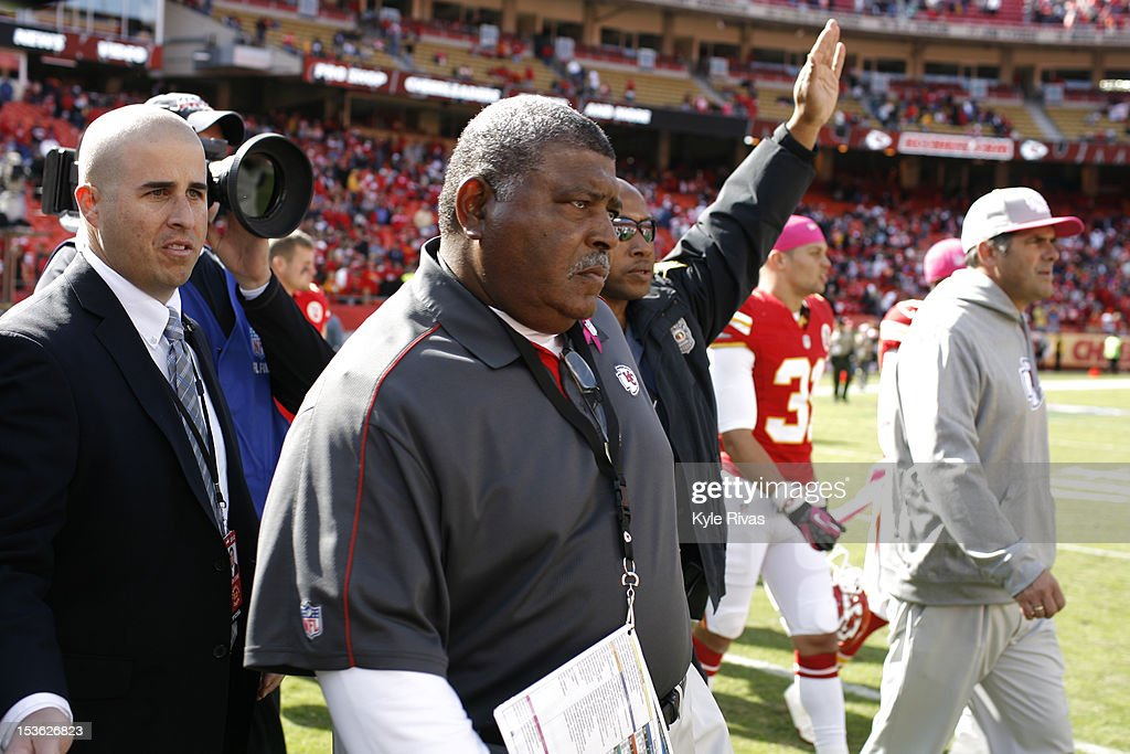 Head coach <a gi-track='captionPersonalityLinkClicked' href=/galleries/search?phrase=Romeo+Crennel&family=editorial&specificpeople=564028 ng-click='$event.stopPropagation()'>Romeo Crennel</a> walks out to shake hands with head coach John Harbaugh of the Baltimore Ravens after the game on October 07, 2012 at Arrowhead Stadium in Kansas City, Missouri.