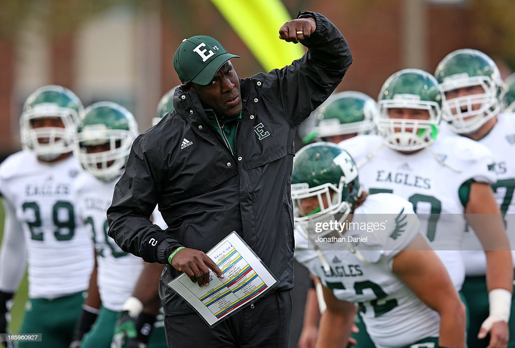 Head coach Ron English of the Eastern Michigan Eagles leads his team onto the field before a game against the Northern Illinois Huskies at Brigham Field on October 26, 2013 in DeKalb, Illinois.