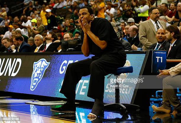 Head coach Ron Hunter of the Georgia State Panthers coaches from a chair during the second round of the 2015 NCAA Men's Basketball Tournament at...