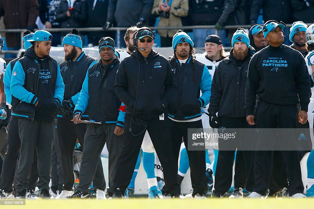 Head coach Ron Rivera and other members of the Carolina Panthers coaching staff look on during the NFC Divisional Playoff Game against the Seattle...