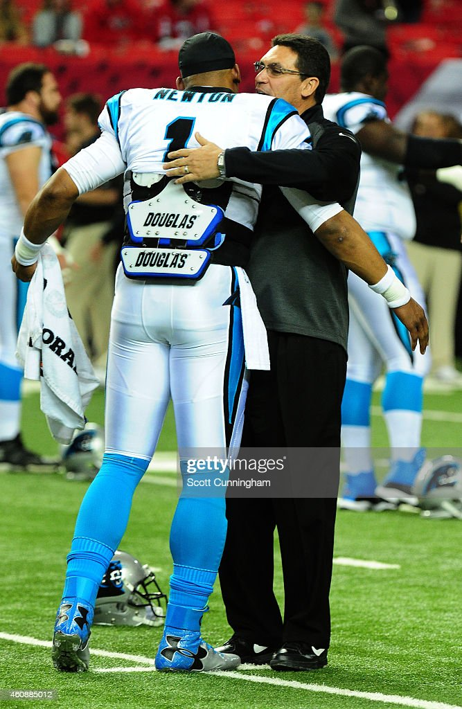 Head Coach Ron Rivera greets Cam Newton of the Carolina Panthers before the game against the Atlanta Falcons at the Georgia Dome on December 28 2014...
