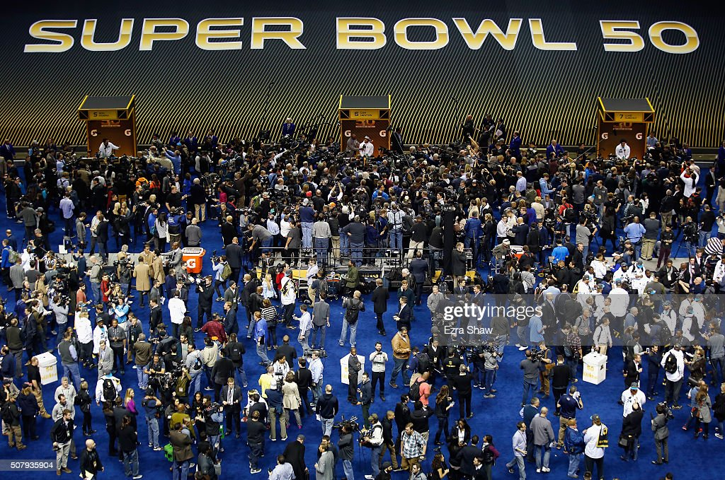 Head coach Ron Rivera of the Carolina Panthers Cam Newton and Luke Kuechly address the media at Super Bowl Opening Night Fueled by Gatorade at SAP...
